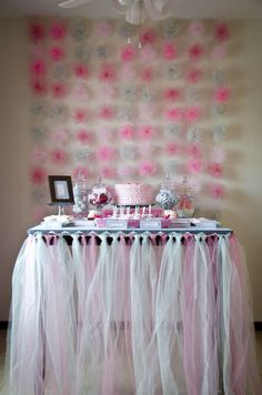 Pom pom backdrop at a winter girl birthday party! See more party planning ideas at CatchMyParty.com!