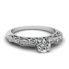 Shop round cut paisley diamond ring in 14k white gold at Fascinating Diamonds. This diamond engagement ring is designed in Pave setting