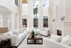 Gorgeous All white transitional style white living room decor with white sofa and white chairs, all white living room decor,