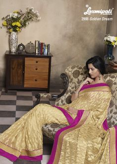 It's really a great pleasure to see this wonderfully designed brasso saree with first rated Zari border work.