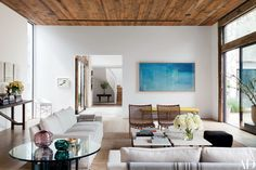 Among the works of art in the living room is an aerial photograph by Richard Misrach.
