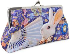 Alice's Adventures in Wonderland Clutch | 37 Ways To Proudly Wear Your Love Of Books
