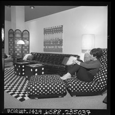 """UCLA Library: """"Caryn Leff relaxing in MOD style living room at the Los Angeles Home Furnishing Mart, 1967""""    Cute hair (and outift)."""