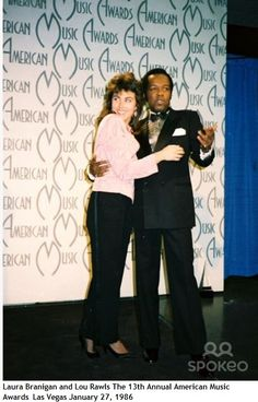 Laura Branigan with Lou Rawls at the 13th annual American Music Awards held at Shrine Auditorium in Los Angeles, Ca. on January 27, 1986.
