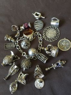 Hey, I found this really awesome Etsy listing at https://www.etsy.com/uk/listing/291067461/vintage-english-charm-bracelet-moveables