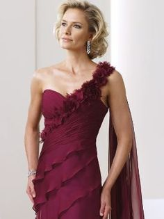 One-shoulder chiffon A-line Mother of the bride dress with modified sweetheart neckline.. The strap trimmed with hand-crafted flowers adds more beauty to the dress.