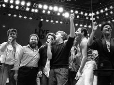 July 13, 1985, from left, George Michael of Wham!, concert promoter Harvey Goldsmith, Bono of U2, Paul McCartney, concert organizer Bob Geldof and Freddie Mercury of Queen join in the finale of the Live Aid famine relief concert, at Wembley Stadium, London.Picture: AP Photo/Joe Schaber