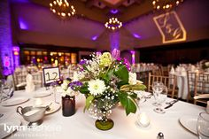 purple themed wedding, table centerpieces for reception.