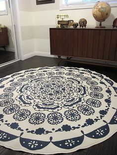 table cloth turned into a rug.  i'd hope it's as beautiful in person.