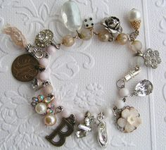 great idea to use the broken/old pieces of jewelry,....Charm Bracelet by andrea singarella, via Flickr
