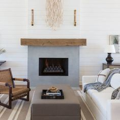 Architectural Digest - Marie Flanigan Interiors - Modern Coastal Texas Home - After: Flanigan simplified the living room with a clean-lined fireplace façade (and, of course, more shiplap).