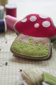 Free Tutorial - Toadstool Needle Book by Cassie.  This is adorable, but I want one shaped like an owl.  Maybe one for my cross-stitch and one for my embroidery.