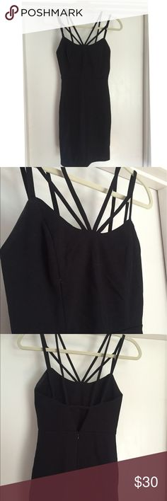 """Black Mini Dress Black mini dress with fun steps! Worn twice for formal event, in great condition! Zip back. (I'm 5'8"""" for length of dress) originally purchased at 344- size small Dresses Mini"""