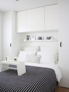 Build in extra storage around your bed Fill in blank wall space around and above your bed and you'll multiply your storage options exponentially. Tall, narrow cupboards on either side of the bed can hold hanging clothes, while a cabinet above the headboard is the perfect spot for stashing books or off-season accessories. By Holly Marder From Houzz.com