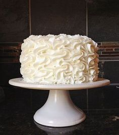 """Frilly Fluffy Cake! Full tutorial from iambaker.net - this cake can be more """"detailed"""" looking or more """"ruffly"""" depending on the pressure you put on the piping bag! Fun and super easy! :D #cakedecorating"""
