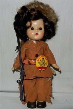 "1954 Ginny Rare Factory Dressed ""Davy Crockett"" Doll. Painted lash doll wearing fringed suede cloth outfit and fur cap, metal toy Kentucky rifle, a…"
