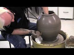 Throwing a pot on a potters wheel