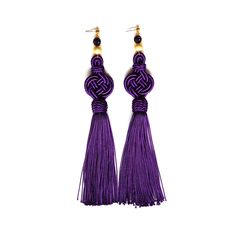 These stunning earrings are inspired by the rich color of the Persian royals, bright purple. These earrings are sure to make a statement with their eye-catching and bright color. This piece is made with 100% handwoven silk tassels and 24k gold plated round bead Shop more Persian-inspired Jewelry online at alangoo.com/spenta-armaiti
