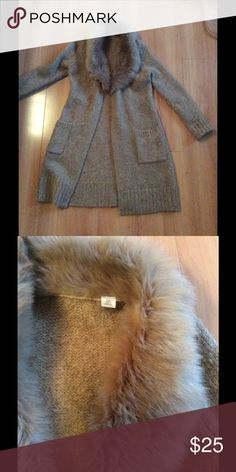 Loft sweater coat w/faux fur Warm and stylish camel colored wool and mohair coat-length cardigan. Matching faux fur collar makes it glam. Cute with jeans and boots. Button front and two front pockets. Has belt loops but no belt. LOFT Sweaters Cardigans