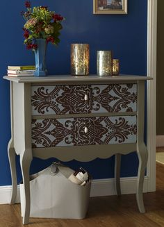 Chest decorated with flocked wallpaper