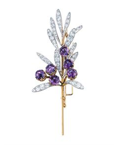 One of Tiffany's exquisite floral creations, a spray brooch by René Lalique (c. 1894). Composed of 12 platinum leaves set with diamonds, and six rose-cut amethysts set in gold Home Features Luxury News Events Luxury Locator Photo Galleries VIP Services Channels