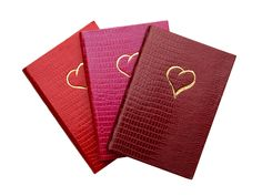 Perfect for sonnets, love poems, and sweet nothings, this trio of heart-adorned, iguana-embossed card notebooks boasts thick, creamy blank pages with gilded edges and grosgrain ribbon bookmarks. Handmade in England by traditionally trained bookbinders.