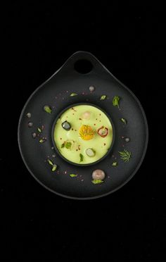 (Maybe) White bean puree with vanilla-bay leaf gel cubes, lemon marshmallows, parsley dust, parsnip chips, molasses-filled apple spheres, almond-Romano bean salad, mango-tomato leather, bean sprout dice, maple syrup-sherry sauce, Guinness bubbles.  The Alinea Project.