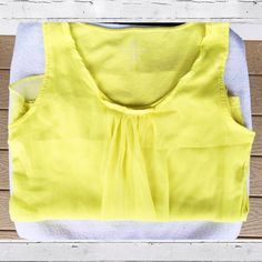 Sunshine yellow sheer overlay tank ☀️ Double layered yellow tank from New York & Company.  Sheer polyester overlay on top of a solid, yellow rayon tank.  Ruffled neckline with front pleating for a delicate, playful look.  No rips/holes/stains. Worn only and in excellent condition. New York & Company Tops Tank Tops