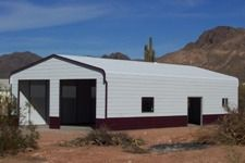 """The Sonoran metal storage building is Absolute Steel's version of a """"Quonset style"""" building – but we think it's got a good deal more style, with its more traditional profile and trim. This is our most economical building style, since it it really needs no frame components other than the main vertical supports and rafter system. Simple, good looking and durable."""