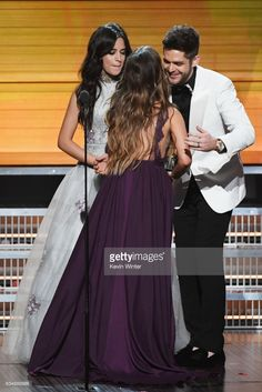Recording artist Maren Morris (C) accepts the Best Country Solo Performance award for 'My Church' from recording artists Camila Cabello (L) and Thomas Rhett (R) onstage during The 59th GRAMMY Awards at STAPLES Center on February 12, 2017 in Los Angeles, California.