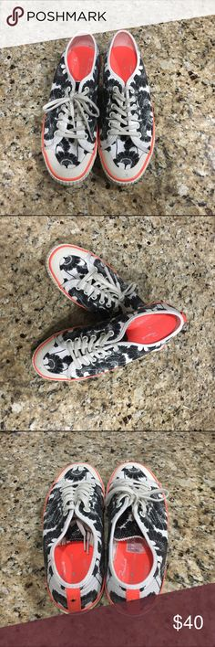 Kate Spade Floral Sneakers, Size 8.5 Check out these fun, playful sneakers from Kate Spade. I love the bright pop of coral color and floral pattern. These sneaks are gently loved and in excellent condition. Size 8.5. Tres chic! kate spade Shoes Sneakers