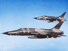 F-105G Wild Weasel with a F-105 Thunderchief in its wing.