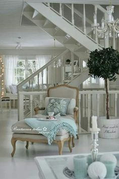 Chic French white decor with just a hint of light Caribbean blue accents