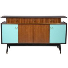 Teak, ebonised and coloured veneer sideboard. | From a unique collection of antique and modern sideboards at http://www.1stdibs.com/furniture/storage-case-pieces/sideboards/