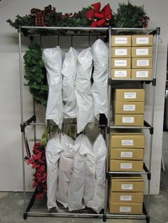 Instead of stuffing artificial wreaths in plastic tubs, keep your wreaths fresh, untangled and ready for the next season using a coat rack. Blogger Karen Way of Sew Many Ways shows how to achieve the ultimate in wreath organization with hangers, plastic bags and labeled boxes to hold wreath decorations.