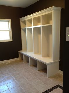 Mudroom simple built ins - next to stacked laundry