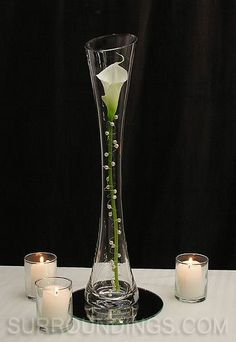 Pearled calla lily in Maria vase candle centerpiece wedding arrangement ikebana Candle Centerpieces, Wedding Centerpieces, Wedding Table, Wedding Decorations, Calla Centerpiece, Simple Centerpieces, Graduation Centerpiece, Quinceanera Centerpieces, Wedding Ideas