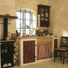 swedish kitchen with cooking range vedspis and fireplace. Black Bedroom Furniture Sets. Home Design Ideas