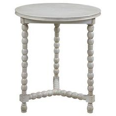 """Cottage white round end table with spooled legs.    Product: End tableConstruction Material: WoodColor: Distressed barn whiteFeatures:   Round shapeTripod spindle legs  Dimensions: 26"""" H x 22"""" DiameterNote: Assembly required"""