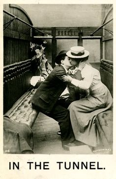 In The Tunnel  (oblivious to the woman drinking her cares away in the corner) 1907 Postcard