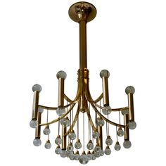 Italian Brass and Glass Chandelier by Sciolari   From a unique collection of antique and modern chandeliers-pendant-lights at https://www.1stdibs.com/furniture/lighting/chandeliers-pendant-lights/