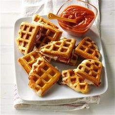 Waffle Iron Pizzas Recipe -These little pizza pockets are a fun mashup using the waffle iron. Try your favorite toppings or even breakfast fillings like ham and eggs. —Amy Lents, Grand Forks, North Dakota