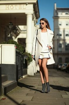 Shop this look for $31:  http://lookastic.com/women/looks/white-skater-skirt-and-white-crew-neck-sweater-and-white-overcoat-and-grey-ankle-boots/1846  — White Skater Skirt  — White Crew-neck Sweater  — White Coat  — Grey Sequin Ankle Boots