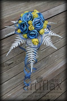 Blue full bloom flax flowers with yellow flax woven rose buds with silver fern and Hapene flax foliage bouquet by Artiflax Flax Weaving, Flax Flowers, Silver Fern, Rose Crafts, Bouqets, Fabric Roses, Boutonnieres, Flower Bouquet Wedding, Beading Tutorials