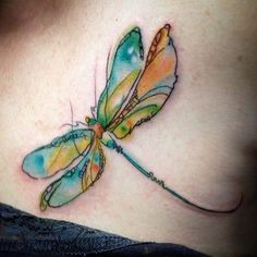 Dragonfly tattoo, on the chest. The dragonfly is simply drawn but it shows the beautiful and matching colors that only the dragonfly can posses; it is beautiful even on its own.