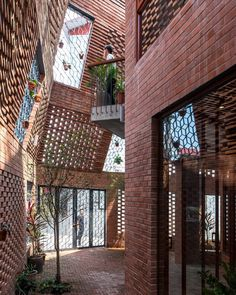 this #vietnamese townhouse in #hanoi is an urban brick cave that simulates nature. H&P architects designed a structure that is made up of,…