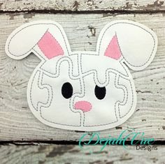 Bunny Felt Puzzle (both ears down). This item and many more are available for purchase at https://www.etsy.com/shop/SchoolhouseBoutique
