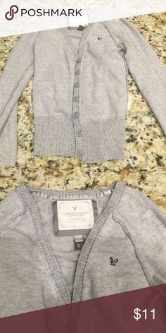 American eagle cardigan Grey American eagle cardigan. Buttons up the front American Eagle Outfitters Tops Button Down Shirts