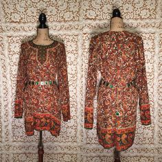 ☼Beautiful Intricate Autumn Colored Paisley Print ☼Wide Sleeves ☼ Side Slits ☼Silky Soft Material ☼Lightweight & Flowy ☼Little Jewels on the Neckline and bottom ☼Dashiki print neckline ☼Midi Length Dress ☼Perfect for any boho babe!!!!!   Brand: No name but made in india! Size: FREE SIZE Measurements [Lying flat]:  ¤Chest: 24 ¤Waist: 23 1/2 ¤Length: 35 ¤Sleeve Length: 23 1/2   Color: dark green orange white golden hues - autumn colors Material: 100% Viscose Feel free to message ...