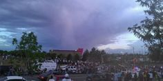 A photo taken by a participant during the memorial for the 12 slain victims in a Aurora, Colorado movie theatre. You can see a beautiful and grand sized 'Angel' inside the cloud hovering over the theatre on July 20, 2012. Days prior a horrific massacre was committed, killing many young people that lived close by and others that attended a college within walking distance.